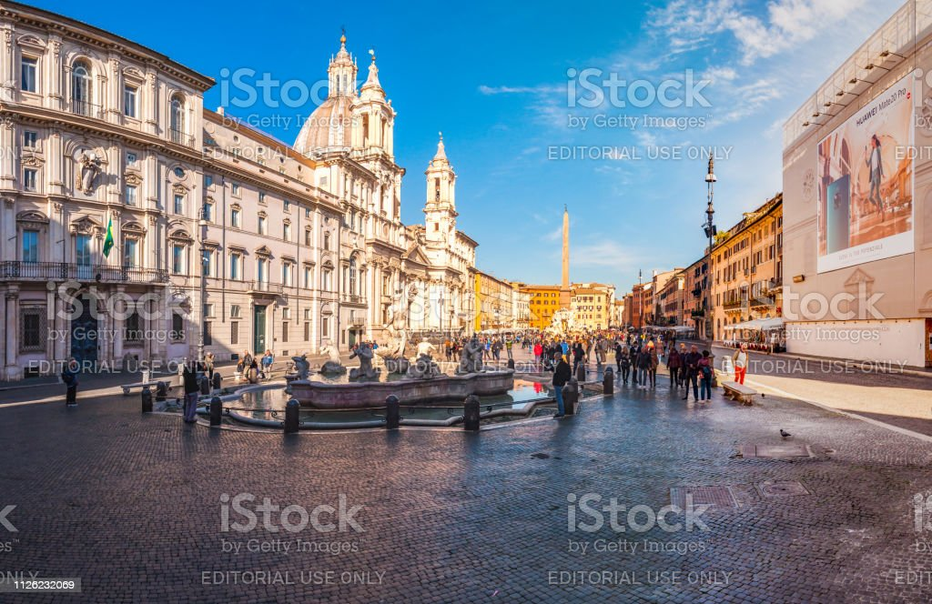 Panorama of Piazza Navona square full of famous fountains,...
