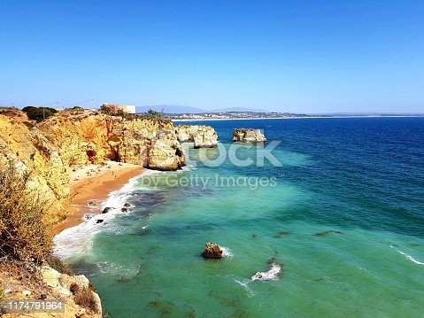 Scenic view of Pinhao Beach on a sunny day in Lagos, Algarve, Portugal
