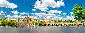 Panorama of Prague city historical centre with Prague Castle, St. Vitus Cathedral in Hradcany district, Charles Bridge Karluv Most across Vltava river. Panoramic view of Prague city, Czech Republic