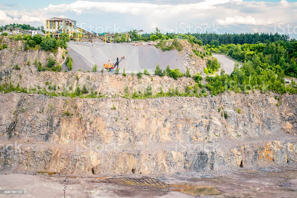 panorama of production in granite quarry stock photo