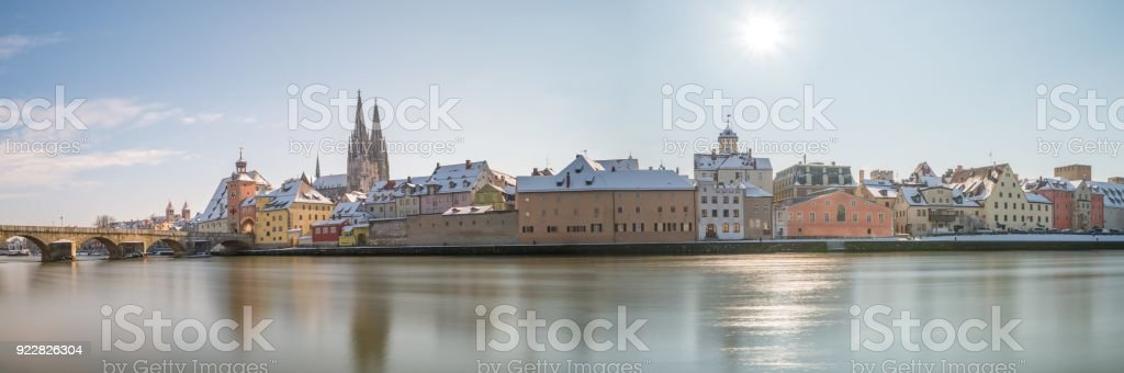 Panorama of Regensburg at winter with the Cathedral and the stone bridge, Germany stock photo