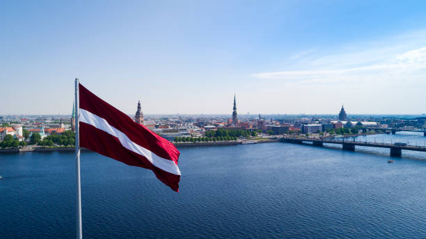 Panorama of Riga city Panorama of Riga city with a big Latvian flag in foreground latvia stock pictures, royalty-free photos & images