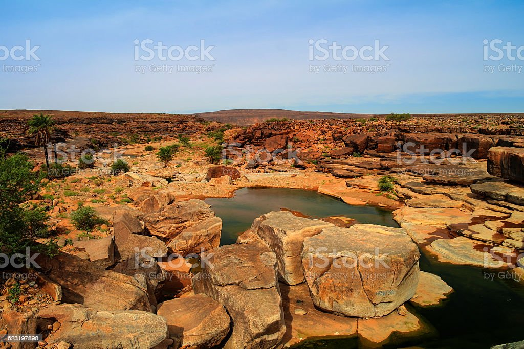 Panorama of rocky pond on Adrar plateau Mauritania stock photo