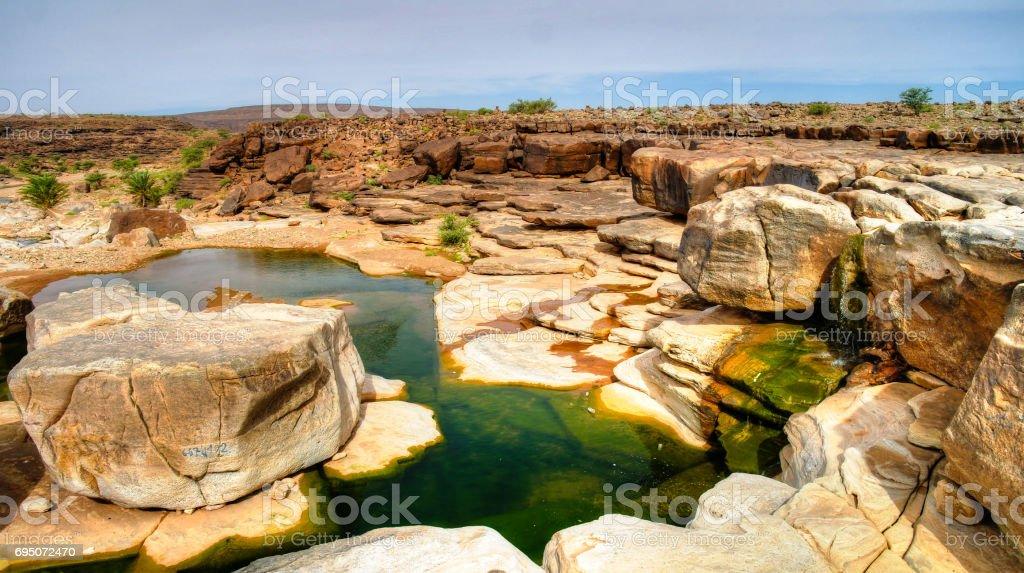 Panorama of rocky pond on Adrar plateau, Mauritania stock photo