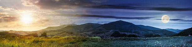 panorama of rural fields in mountains stock photo