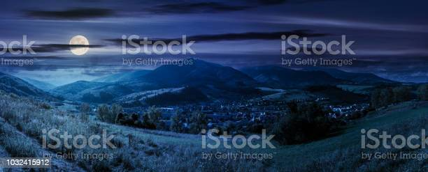 Photo of panorama of rural fields on curvy slopes at night