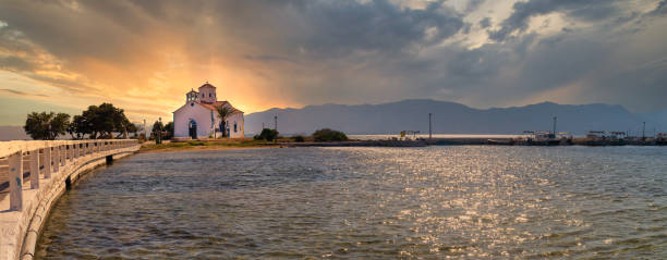 Panorama of Saint Spyridon church in Elafonisos in Greece against the sunset. stock photo