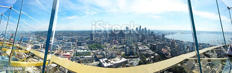 Seattle from Space Needle, Seattle, United States. Panoramic wide angle view of Seattle City centre and Puget Sound on sunny day in summer