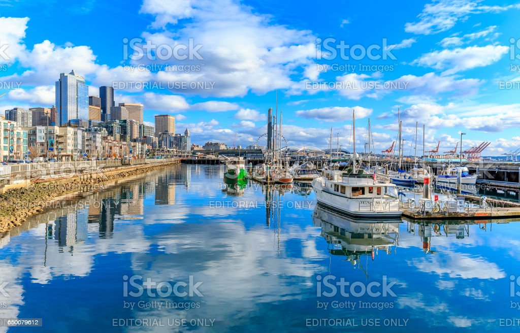 Panorama of Seattle waterfront with the city skyline on a sunny cloudy day stock photo