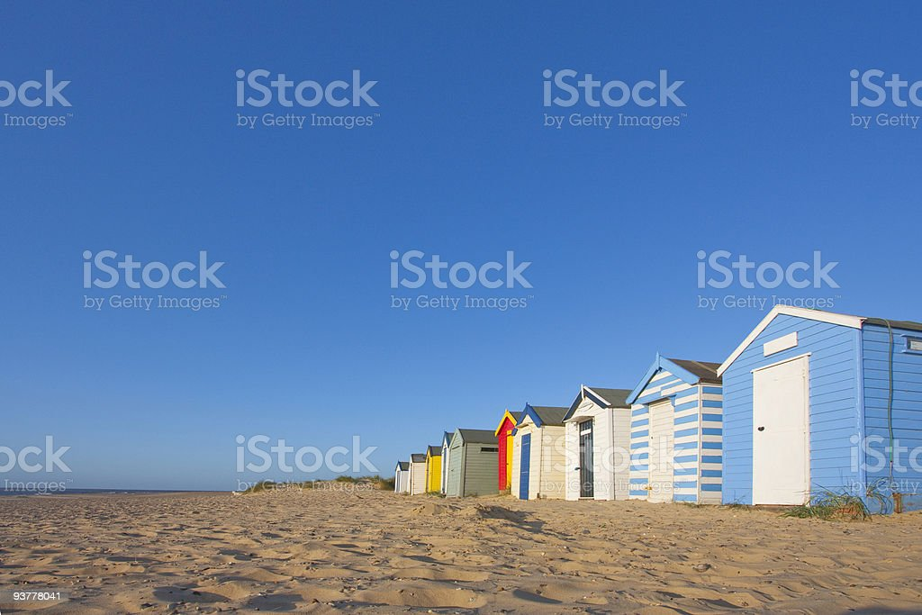 Panorama of set of southward colorful beach huts stock photo