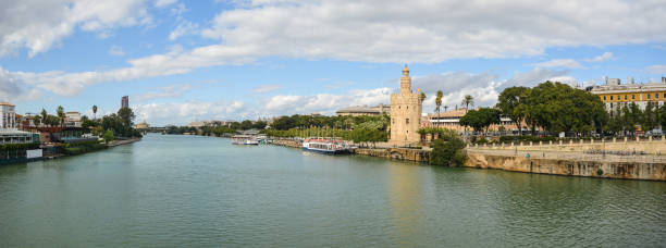 Panorama of Seville, the Golden Tower and the embankment. stock photo