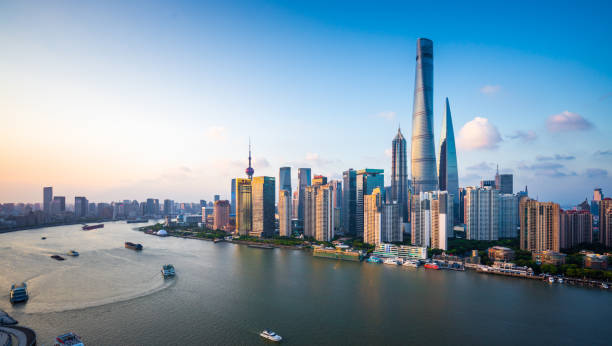 Panorama of Shanghai Skyline Aerial view of modern skyscrapers in Lujiazui Financial District at dusk. shanghai stock pictures, royalty-free photos & images