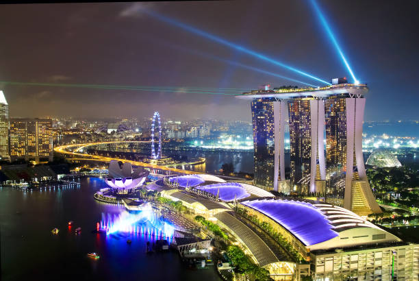 panorama of singapore city skyline at night, aerial view. - marina bay sands stock photos and pictures