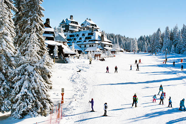 Panorama of ski resort Kopaonik, Serbia, people, houses, restaurants stock photo
