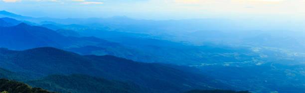 panorama of sky with cloud over high mountain in thailand - baumwipfelpfad stock-fotos und bilder