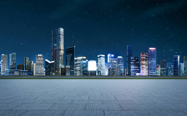 Panorama of skyscrapers in a modern city Side angle view empty asphalt road with stone marble floor and city skyline background . Mixed media . ziek stock pictures, royalty-free photos & images