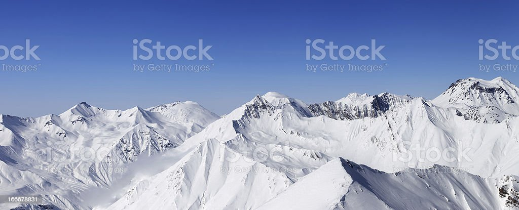 Panorama of snow mountains and blue sky stock photo