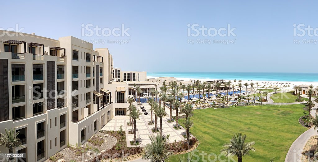 Panorama of swimming pools and beach at the luxury hotel stock photo