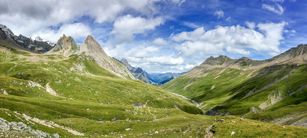 istock Panorama of the Alps in summer. View on the Seigne pass (col de la seigne) in Italy during Tour du Mont Blanc hike 938472650