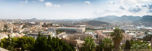 panorama of the city of cartegena. a town located in the region of murcia, by the mediterranean coast, south-eastern spain showing the roman theatre of carthago nova - cartagena museum stock photos and pictures