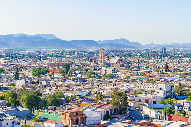 Panorama of the city of Saltillo in Mexico. Saltillo, Mexico - June 3, 2013: Panoramic view at the town of Saltillo in Mexico. It is called the Detroit of Mexico due to large amount of car manufacturers in this town. coahuila state stock pictures, royalty-free photos & images