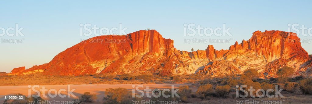 Panorama of the colorful cliffs at Rainbow Valley in the evening sun stock photo