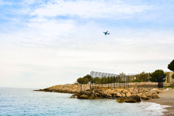 Panorama of the French Riviera with flying plane stock photo