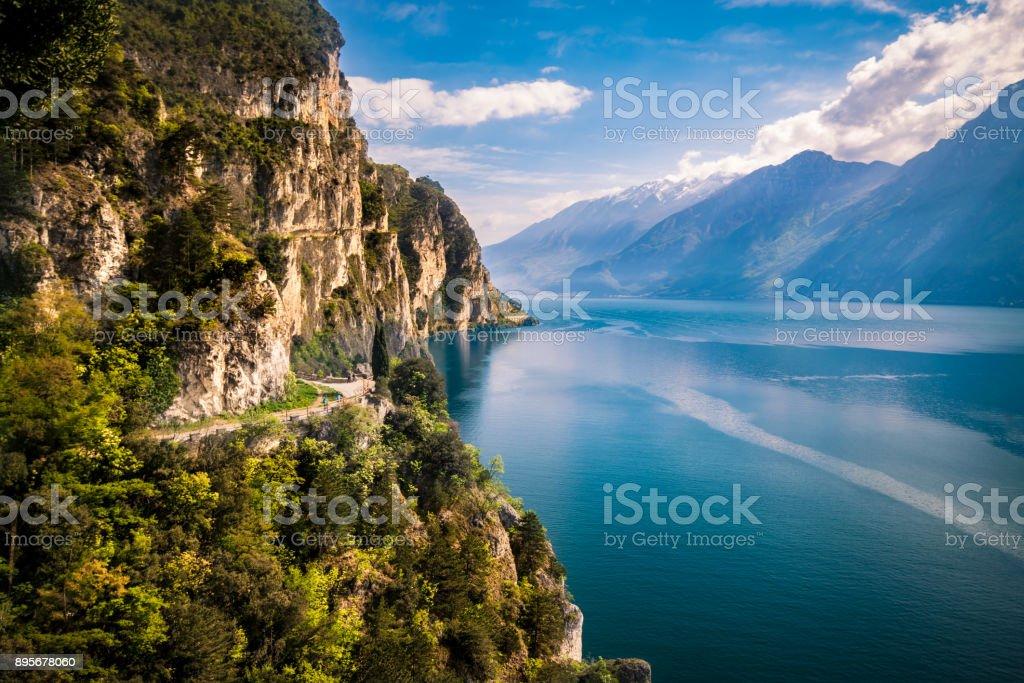Panorama of the gorgeous Lake Garda surrounded by mountains. stock photo