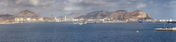panorama of the industrial port of the city of cartagena , showing gas and oil storage containers. cartagena is a town located in the region of murcia, by the mediterranean coast, south-eastern spain showing the roman theatre of carthage nova - cartagena museum stock photos and pictures