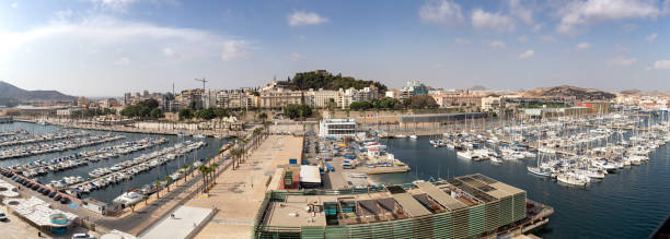 panorama of the marina in the city of cartagena , showing a number of sailing boats. - cartagena museum stock photos and pictures