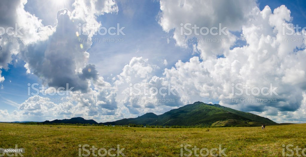 Panorama of the mountain kokshetau in the steppe among the stones and steppe grass in Kazakhstan stock photo