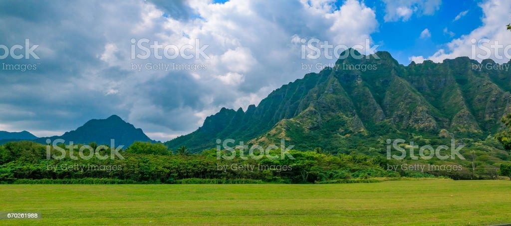 Panorama of the mountain range by famous Kualoa Ranch in Oahu, Hawaii where  'Jurassic Park' was filmed stock photo