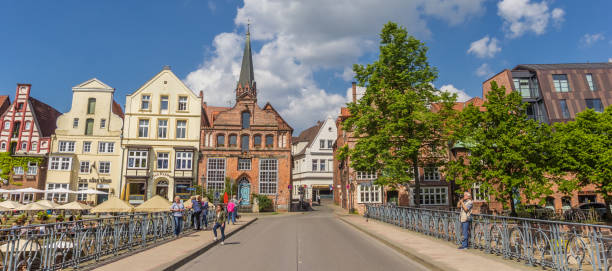 Panorama of the old bridge in the historic harbor of Luneburg, Germany Luneburg, Germany - May 21, 2017: Panorama of the old bridge in the historic harbor of Luneburg, Germany lüneburg stock pictures, royalty-free photos & images