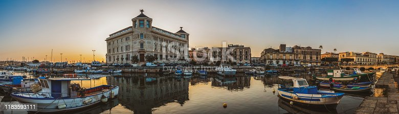 Panoramic view of the famous Ortygia island from the bridge Umberto at sunset in the province of Syracuse in Sicily, south Italy