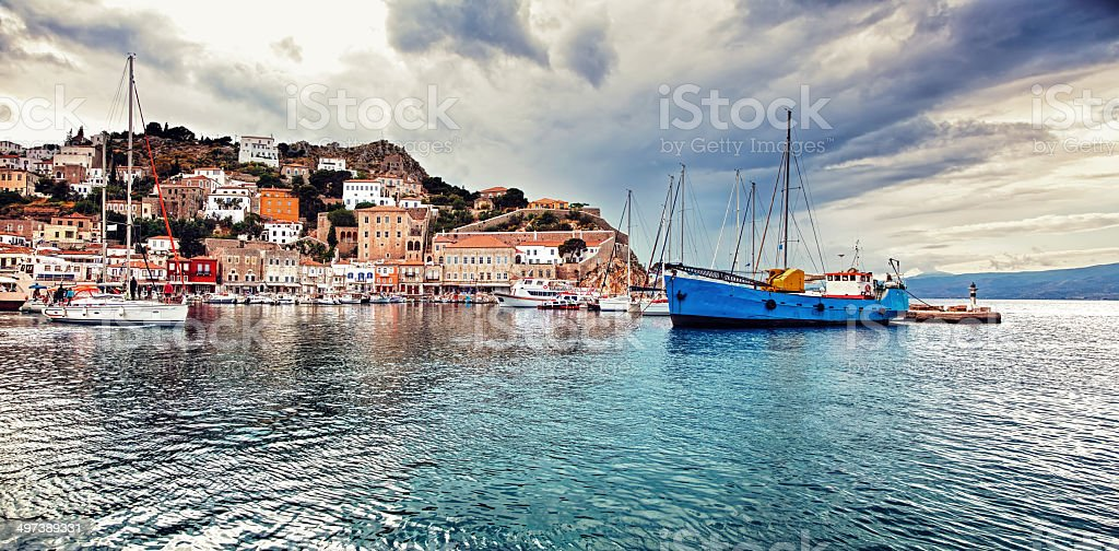 Panorama of the port of Hydra, Greece, under moody sky stock photo