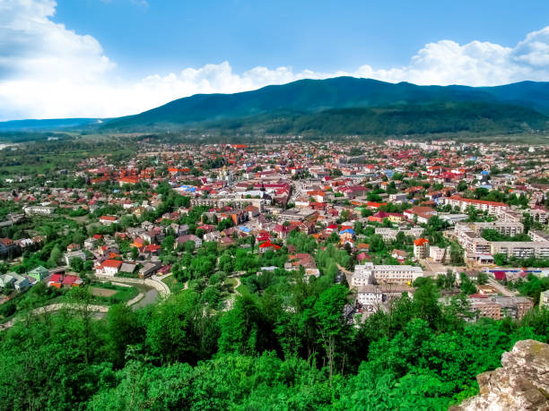 Panorama of the provincial Transcarpathian town of Khust in the Carpathian valley (Ukraine) stock photo