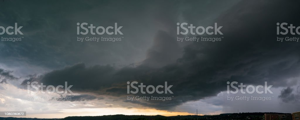 Panorama of the sky during a thunderstorm. Dark dramatic stormy sky.