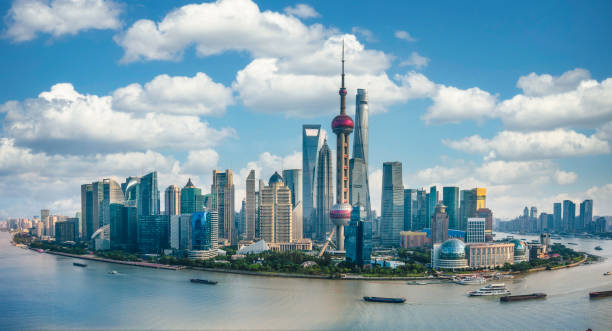 Panorama of the skyline of Shanghai urban and huangpu river Panorama of the skyline of Shanghai urban and huangpu river, China, on a sunny day pudong stock pictures, royalty-free photos & images