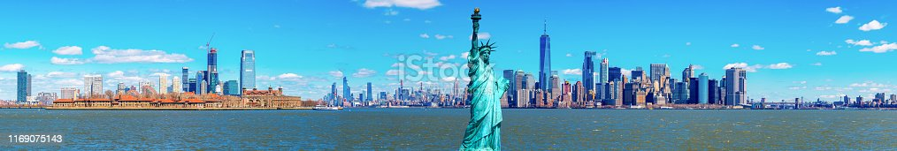 istock Panorama of The Statue of Liberty with the One world Trade building center over hudson river and New York cityscape background, Landmarks of lower manhattan New York city. 1169075143