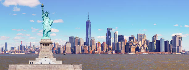 Panorama of The Statue of Liberty with the One world Trade building center over hudson river and New York cityscape background, Landmarks of lower manhattan New York city. stock photo