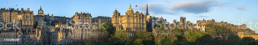 Panorama of the sun rising in Edinburgh stock photo