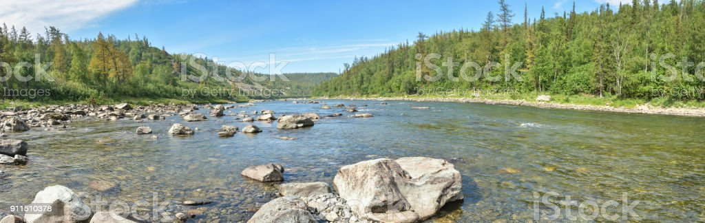 Panorama of the taiga river in the Polar Urals. stock photo