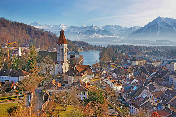 panorama of thun church and town with thunersee and alps - thun switzerland stock-fotos und bilder