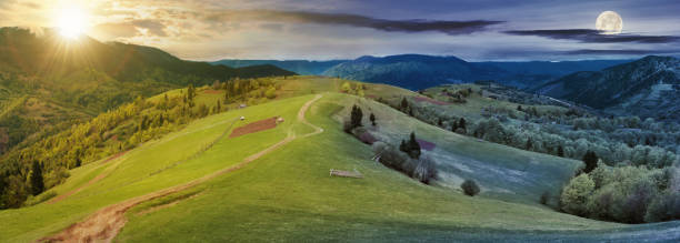 panorama of time change above countryside stock photo