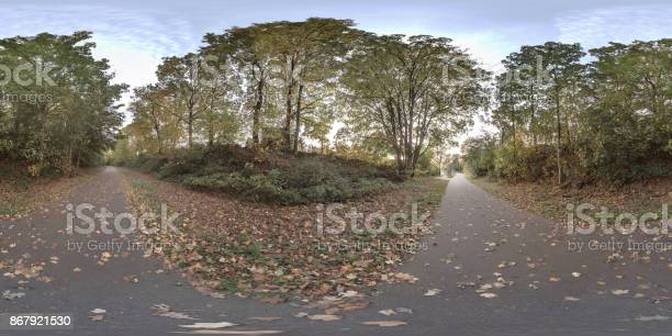 Panorama of tree lined walk trail with green brown orange leafs in picture id867921530?b=1&k=6&m=867921530&s=612x612&h=q9in2eifap3zejlflyjqg7gklkbhy2j uula 9q i5k=