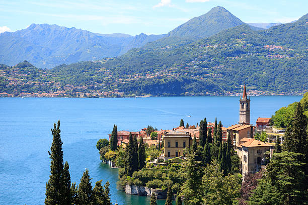 panorama of varenna at lake como with mountains in italy - lake como stock photos and pictures