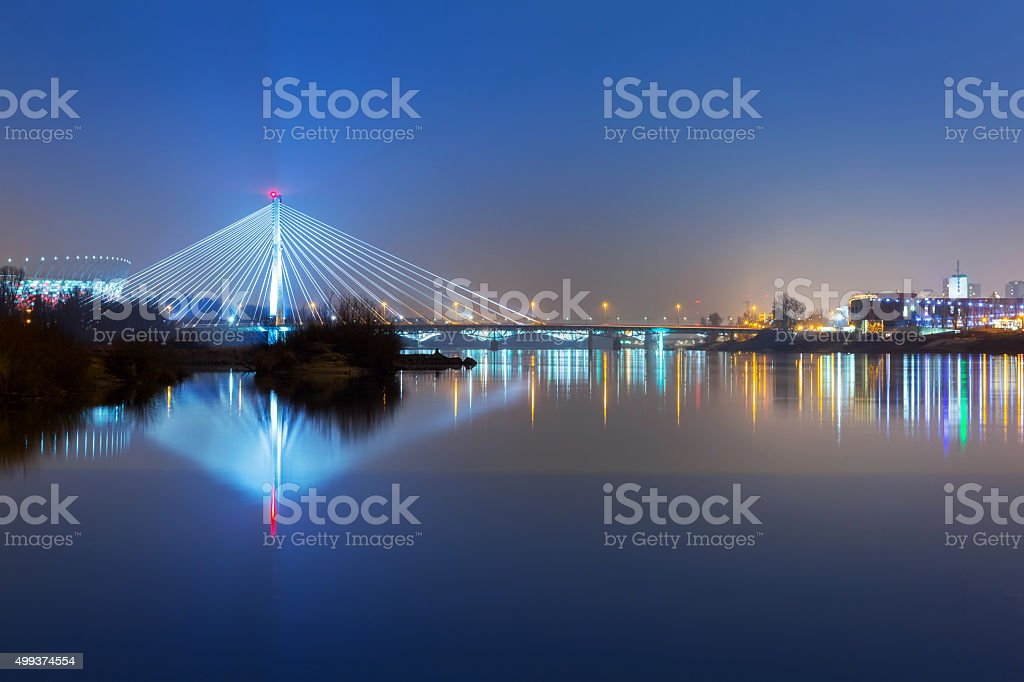 Panorama of Warsaw at night with reflection in Vistula river stock photo