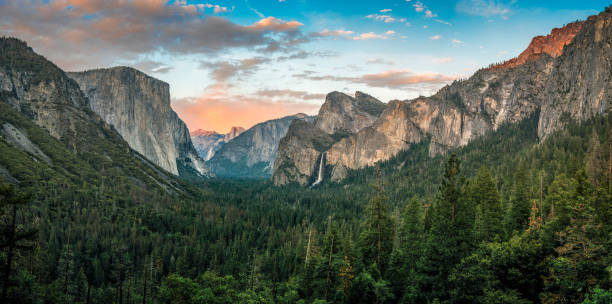 Panorama of Yosemite Valley at sunset Panorama of Yosemite Valley at sunset el capitan yosemite national park stock pictures, royalty-free photos & images