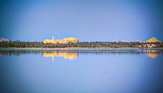 istock Panorama of Zaytun lake, Ruins of the Amun Oracle temple and mountain Dakrour in Siwa oasis, Egypt in Siwa oasis, Egypt 870031774