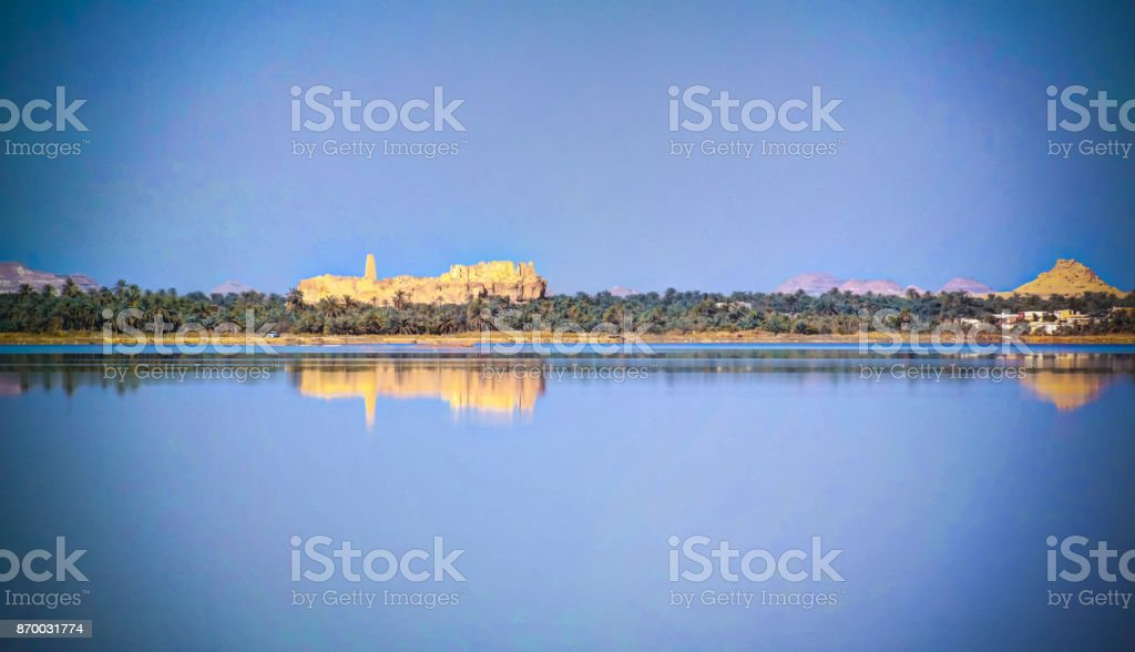 Panorama of Zaytun lake, Ruins of the Amun Oracle temple and mountain Dakrour in Siwa oasis, Egypt in Siwa oasis, Egypt stock photo